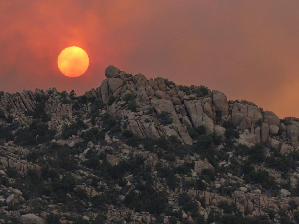 Sun about to drop behind the rocks of Granite Mountain at the end of the first day of the Doce Fire in 2013